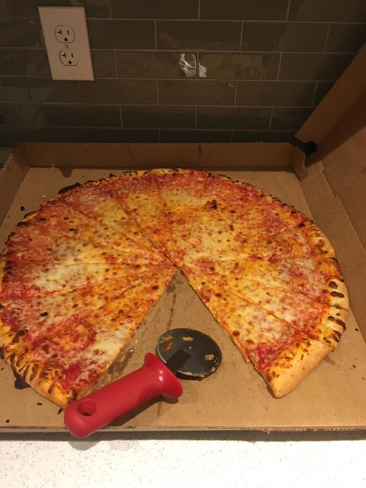 Pizza in box with 1 slice removed