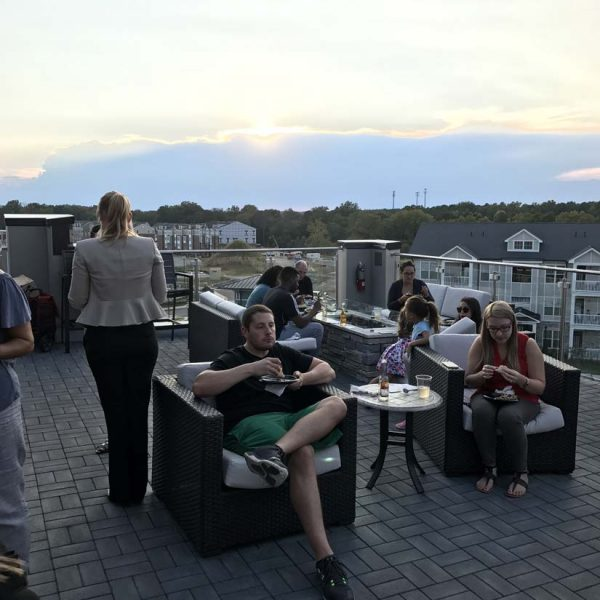 Residents enjoying food on rooftop