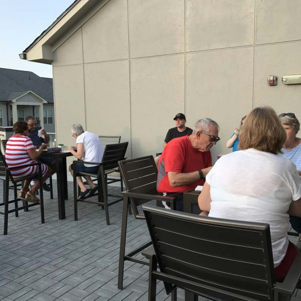 Residents eating at tables on rooftop