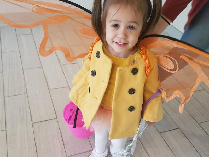 Little girl in pigtails with wings, for Halloween