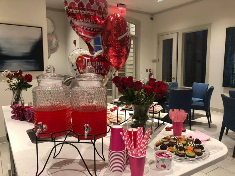 Table with red drinks & cups