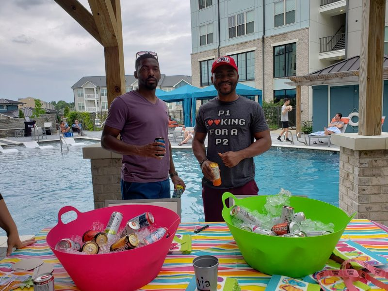 2 guys posing at pool party