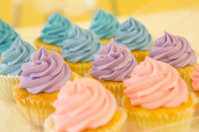 Cupcakes with blue, purple & pink icing